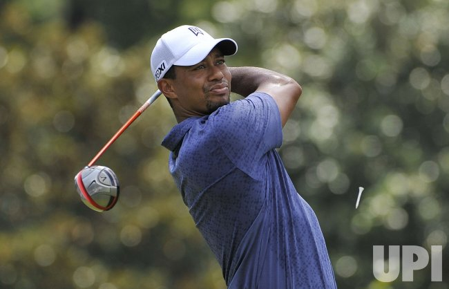 Woods tees off on 3rd hole at 93rd PGA Championship