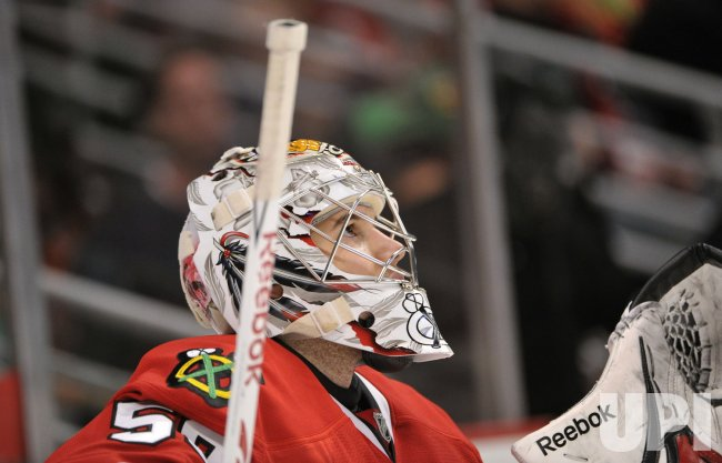 Blackhawks Crawford looks at scoreboard against Sharks in Chicago