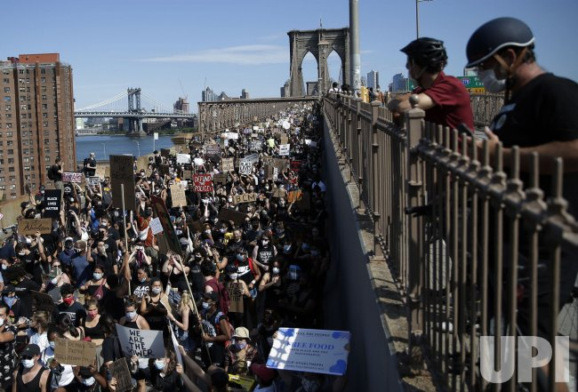 Marchers on the Brooklyn Bridge for Juneteenth Holiday In NYC
