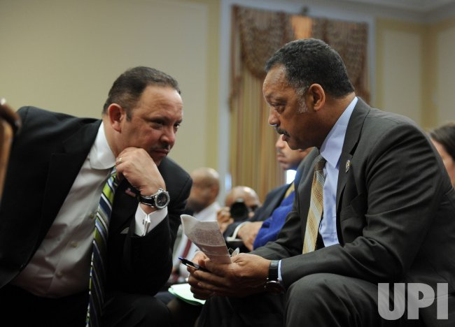 National Urban League President Marc Morial talks to Rev. Jesse Jackson in Washington