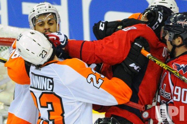 Brandon Manning hits Alex Ovechkin
