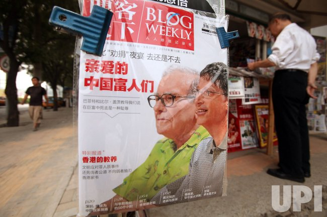 Magazine features Warren Buffett and Bill Gates on front page in Beijing