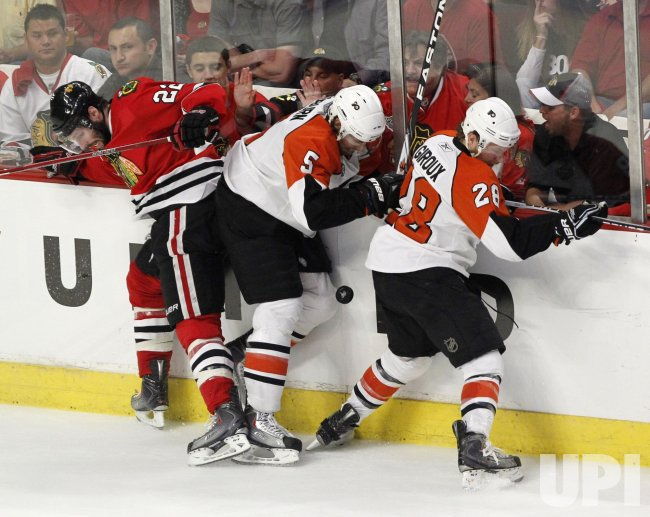 Brouwer, Coburn and Giroux go for puck during the 2010 Stanley Cup Final