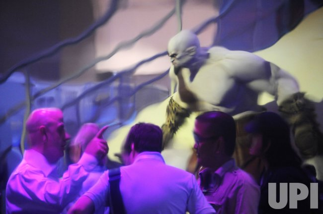 Attendees are reflected on a metallic wall during E3 in Los Angeles