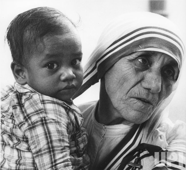 Mother Teresa holds a toddler at the Calcutta orphanage