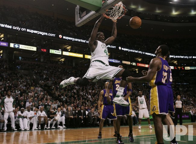 Celtics Perkins dunks against Lakers in Boston, MA.