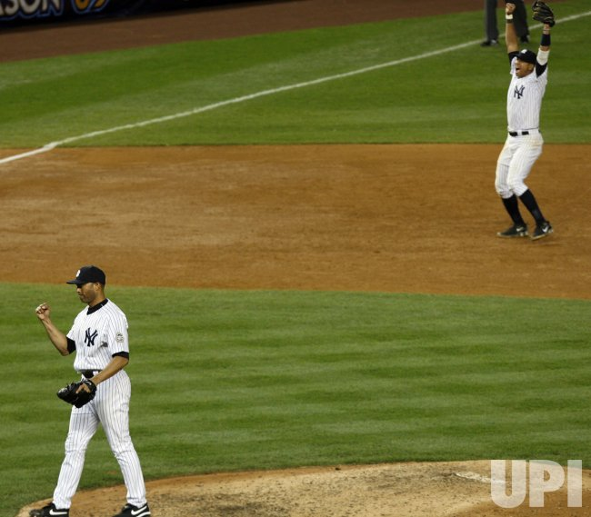 New York Yankees Alex Rodriguez and Mariano Rivera react at the end of game 6 of the ALCS against the Los Angeles Angels of Anaheim at Yankee Stadium in New York