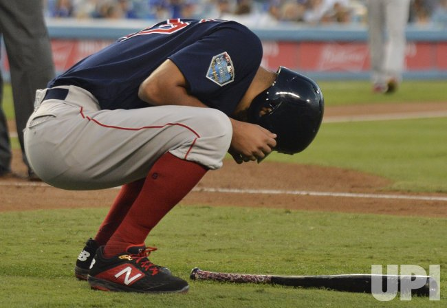 Red Sox pitcher Rodriguez reacts after being hit by pitch during third inning in Game 4 of the World Series
