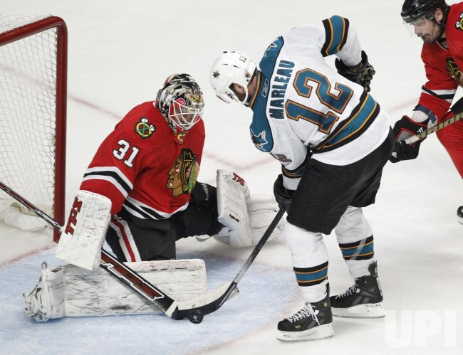 Blackhawks Niemi saves shot by Sharks Marleau in Chicago