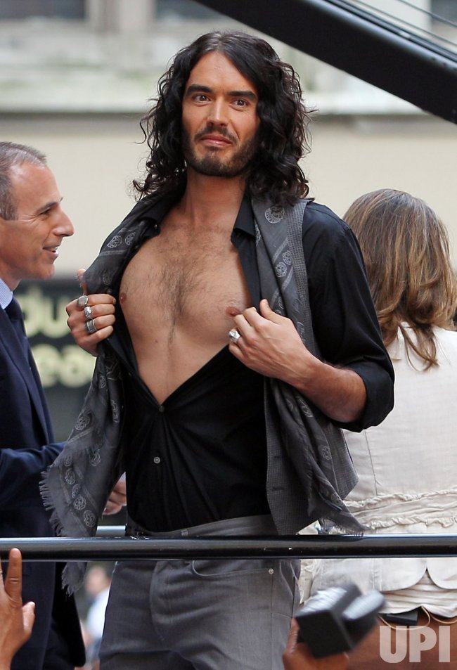Russell Brand opens up his shirt at Rockefeller Center in New York