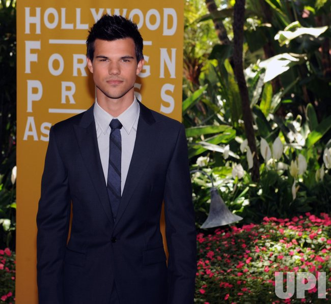 Taylor Lautner attends the Hollywood Press Association luncheon in Beverly Hills