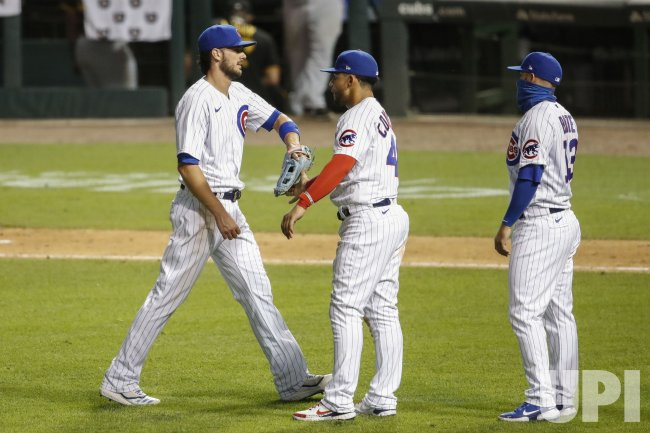 Chicago Cubs players celebrate after defeating the Pittsburgh Pirates at Wrigley Field in Chicago