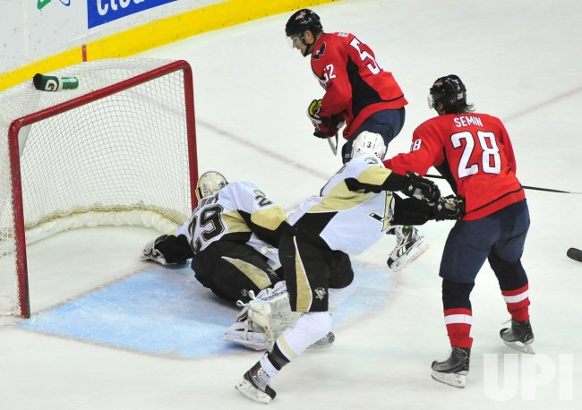 Penguins' goalie Marc-Andre Fleury stops a shot in Washington