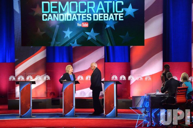 Democratic Presidential Candidates Clinton and Sanders talk on stage