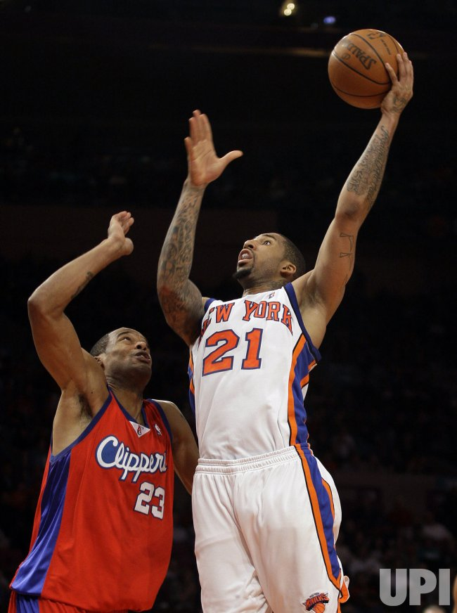 New York Knicks Wilson Chandler drives to the basket and Los Angeles Clippers Marcs Camby plays defense in the fourth quarter at Madison Square Garden in New York