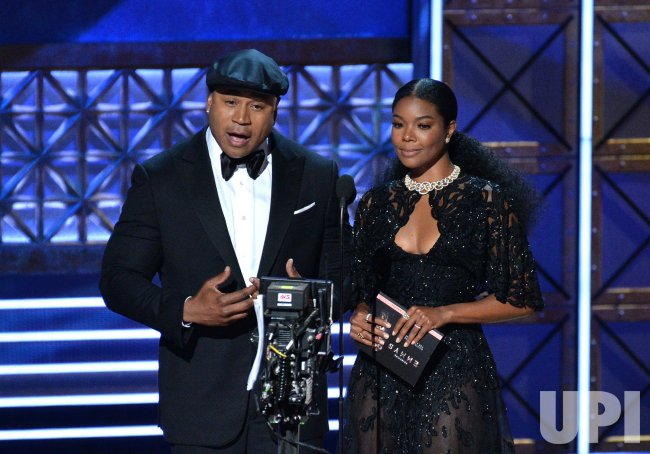 LL Cool J and Gabrielle Union onstage at the 69th annual Primetime Emmy Awards in Los Angeles