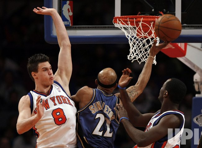 New York Knicks Danilo Gallinari tries to block a shot by Washington Wizards Fabrico Oberto at Madison Square Garden