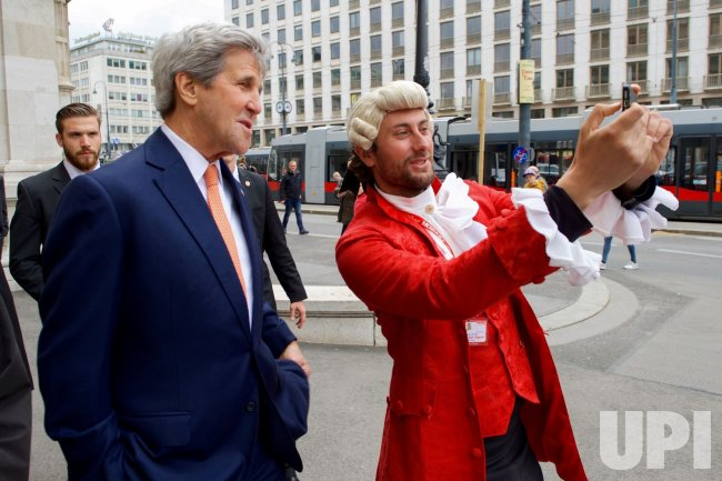 Secretary John Kerry poses for a selfie with a Mozart impersonator in Vienna