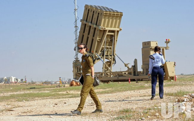 Israeli soldiers stand near the new Israeli anti-rocket system, the Iron Dome, in southern Israel