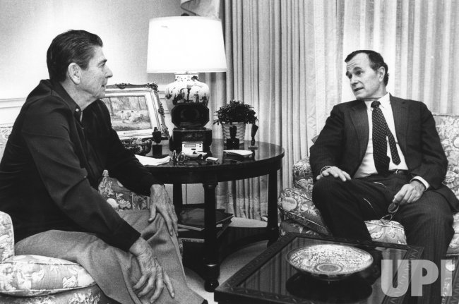 President Reagan Talks with Vice President Bush After Return from Beirut