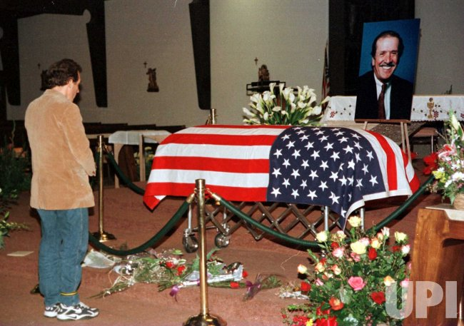 A mourner pays his last respects to the flag draped casket of entertainer and politician Sonny Bono