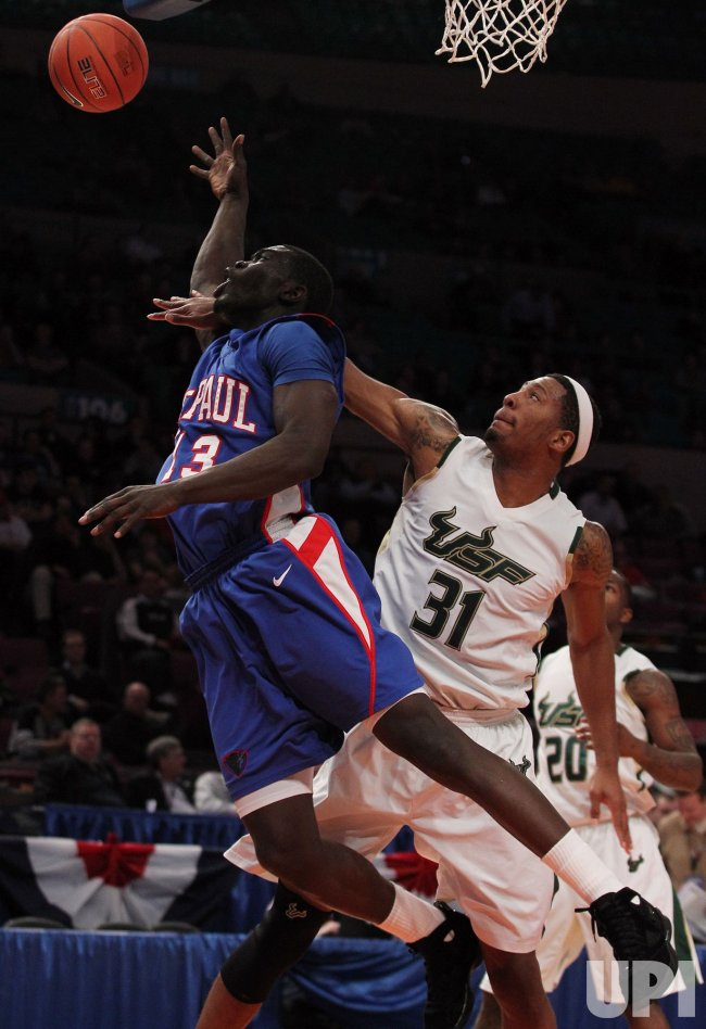 USF Bulls USF Bulls Jarrid Famous (31) plays defense on DePaul Blue Demons Mac Koshwal at the NCAA Big East Men's Basketball Championships in New York