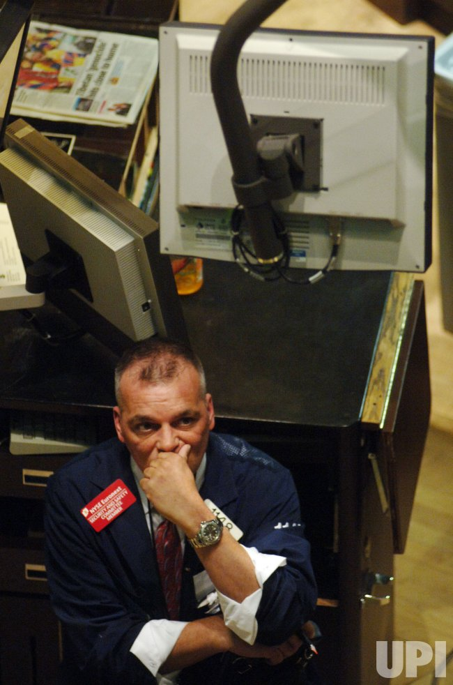Traders on the floor of New York Stock Exchange in New York