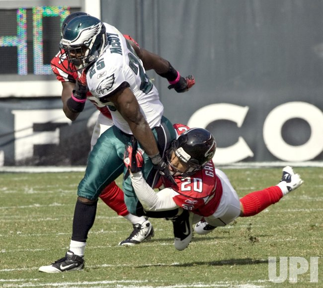 Atlanta Falcons Grimes hangs onto Philadelphia LeSean McCoy on the Philadelphia 34-yard line