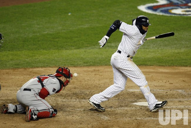 New York Yankees Robinson Cano reacts after a ball gets by him in the seventh inning against the Los Angeles Angels of Anaheim in game 1 of the ALCS at Yankee Stadium in New York