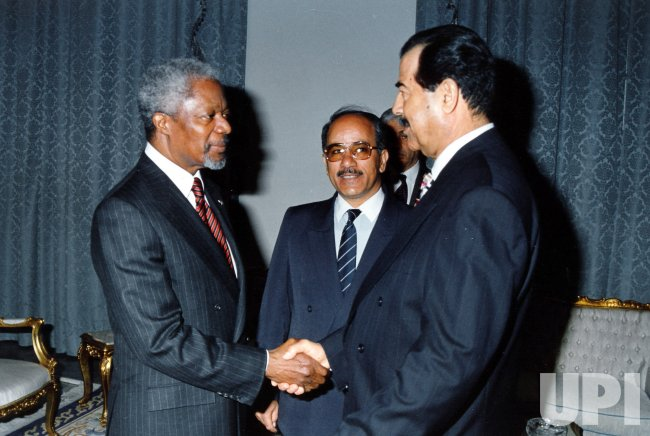 UN Secretary General Kofi Annan meets with Iraqi President Saddam Hussein