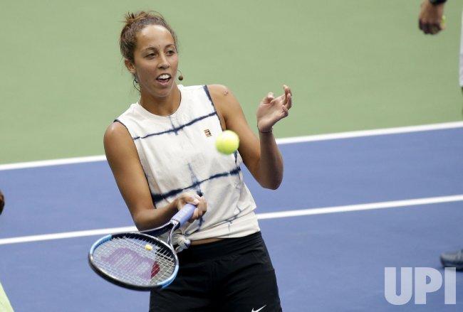 Madison Keys hits tennis balls at Arthur Ashe Kids Day