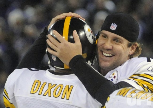 Steelers Roethlisberger hugs teammate Dixon after a touchdown against Ravens in Baltimore