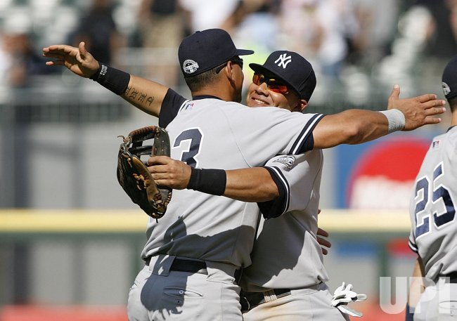 New York Yankees' Alex Rodriguez and Melky Cabrera celebrate their win over the Chicago White Sox; celebration; hug; reaction