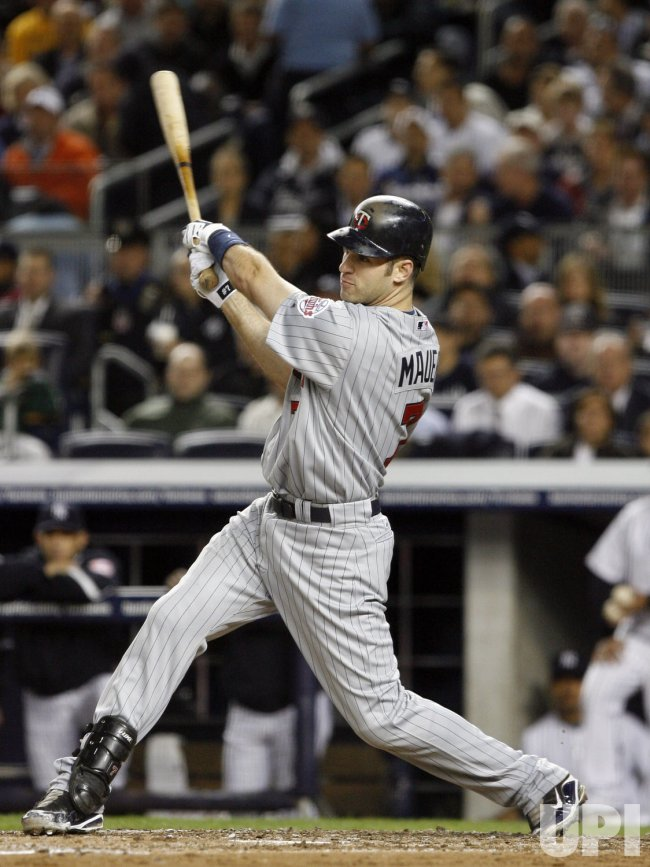 Minnesota Twins Joe Mauer hits a double in the third inning against the New York Yankees in game 1 of the ALDS at Yankee Stadium in New York