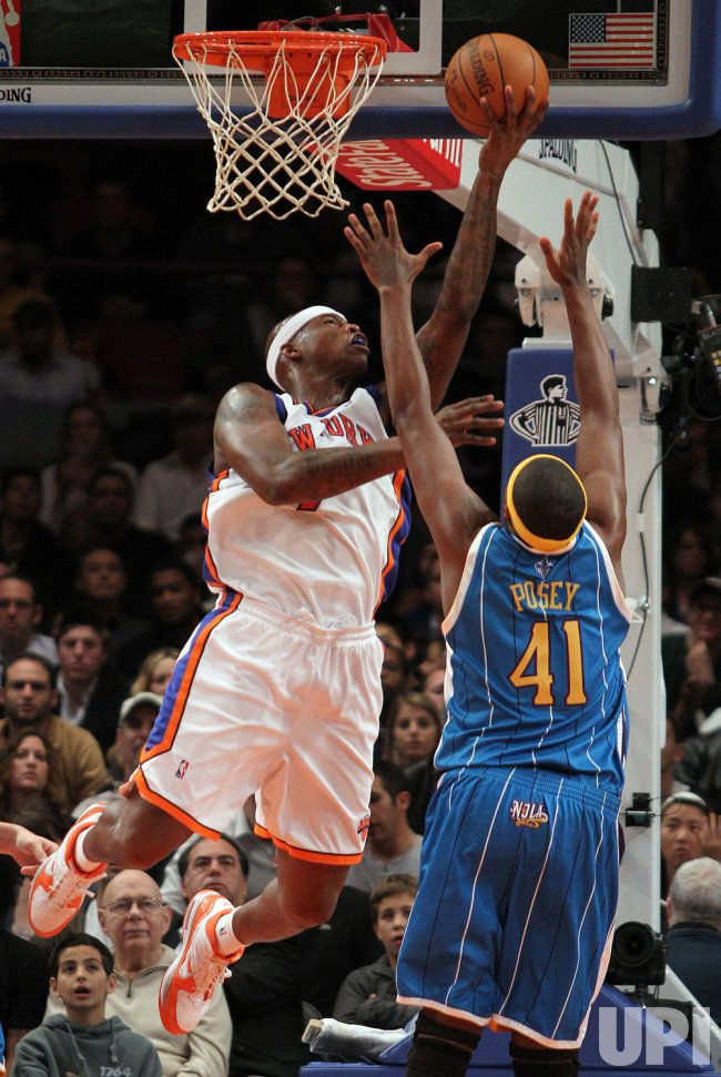 New York Knicks Al Harrington scores over New Orleans Hornets James Posey in the first half at Madison Square Garden in New York