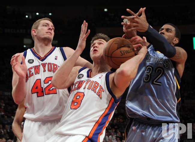 New York Knicks Danilo Gallinari (8), David Lee (42) and O.J. Mayo fight for a rebound at Madison Square Garden