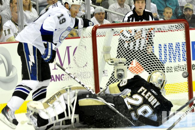 Pens Fleury Makes Saves on Lightnings Moorein Pittsburgh