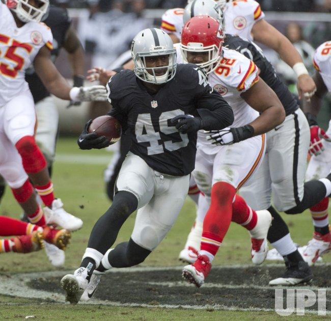 Raiders Jamize Olawale runs against Kansas City Chiefs