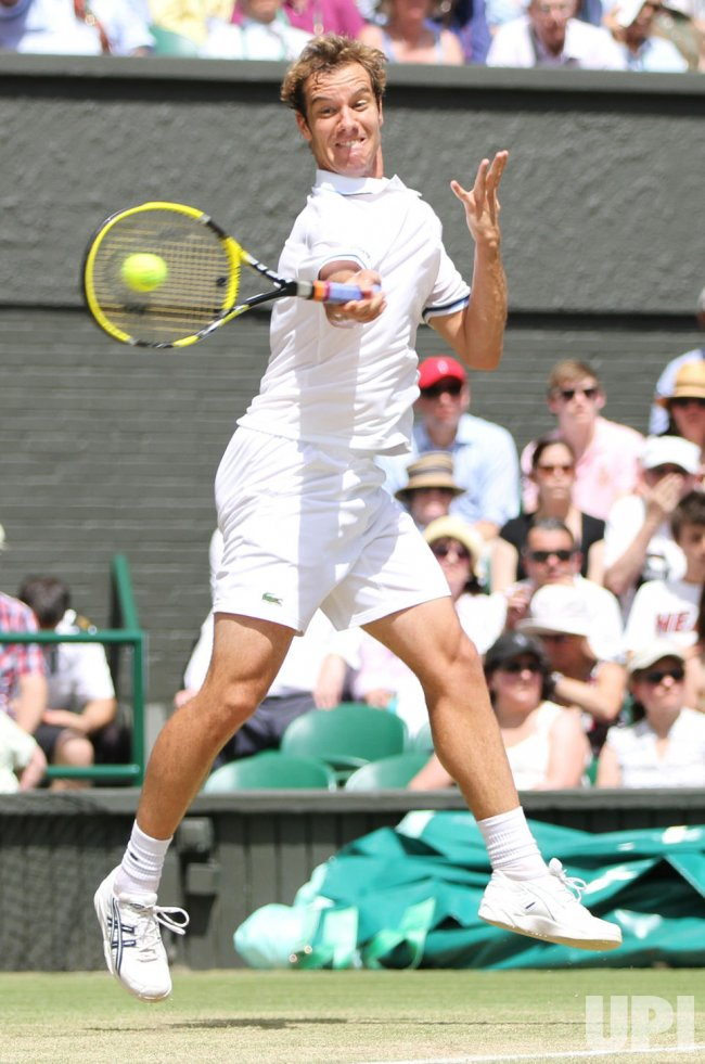 Richard Gasquet returns at Wimbledon.