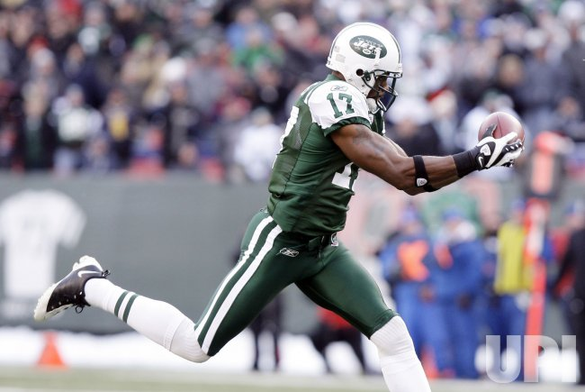 New York Jets Braylon Edwards catches a 65 yard touchdown pass against the Atlanta Falcons at Giants Stadium in New York