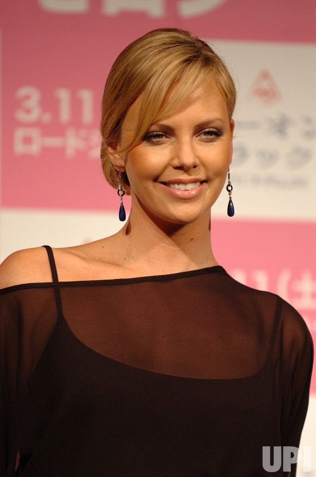CHARLIZE THERON PROMOTES HER MOVIE