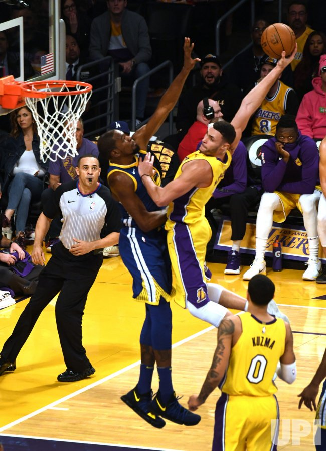 Lakers Larry Nance Jr prepares to dunk on Warriors Kevin Durant