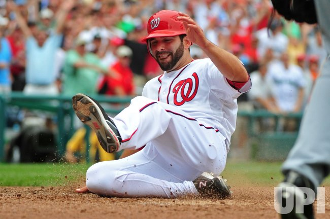 Nationals' Danny Espinosa scores against the Seattle Mariners in Washington