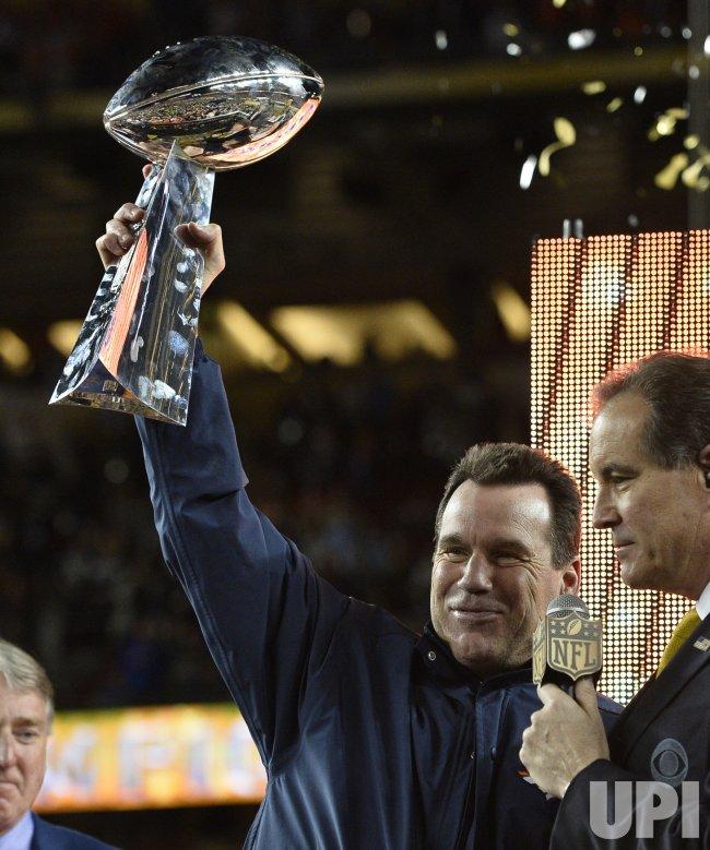 Denver Broncos Head Coach Gary Kubiak holds the Lombardi Trophy