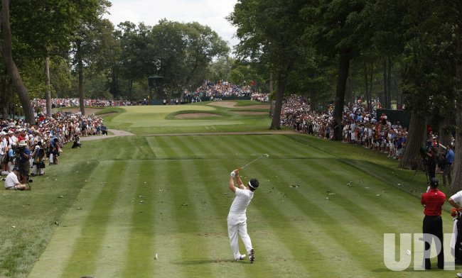 Y. E. Yang tees off on the fourth hole during the final round of the 91st PGA Championship in Chaska, Minnesota