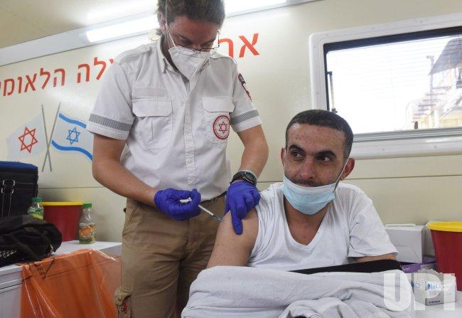 A Palestinian Receives The Pfizer-Biotech Coronavirus Vaccine In Jerusalem