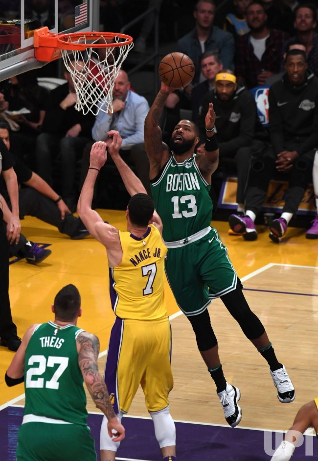 Celtics Marcus Morris shoots over Lakers Larry Nance Jr at Staples Center