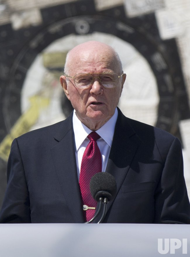John Glenn speaks at a transfer ceremony for Space Shuttle Discovery at the Smithsonian's National Air and Space Museum's Udvar-Hazy Center in Virginia