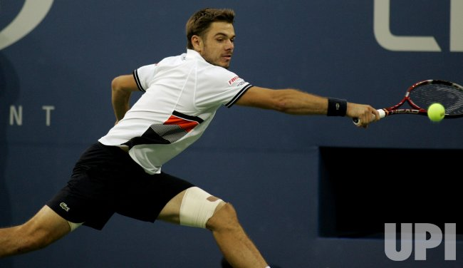Stanislas Wawrinka and Mikhail Youzhny play quarter final match at the U.S. Open in New York