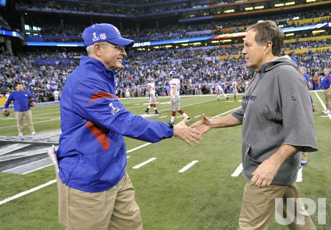 Giants Head Coach Coughlin Greets Patriots Head Coach Belichick at Super Bowl XLVI in Indianapolis